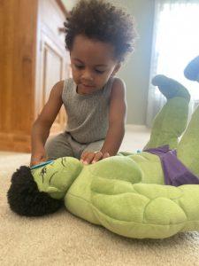 Child Examining Dolls Eyes